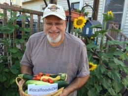 Photo of a man holding a basket of locally grown vegetables. Photo by O S U College of Food, Agricultural and Environmental Sciences